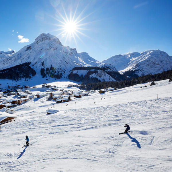 Skiing with a view of Lech and the Hotel Auriga